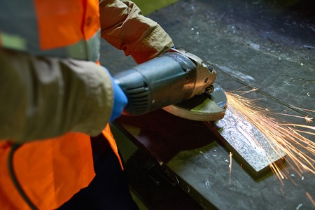 Man Working with Metal at Factory Stock Photo - 98207162