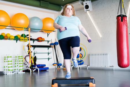 Obese Woman Doing Step Fitness 免版税图像