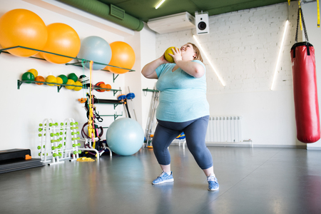 Overweight Woman Doing Squats Stockfoto