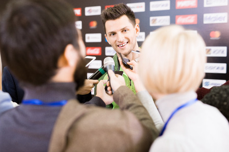 Gold Medalist Talking to Journalists