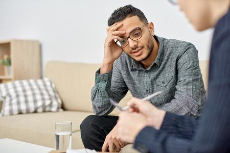 Psychologist Consulting Depressed Patient