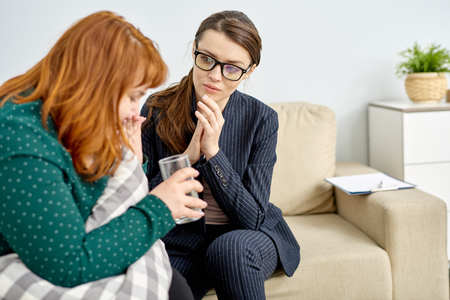 Obese Woman Crying at Therapy Session Stock Photo