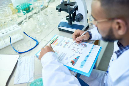 Arabian scientist analyzing research results