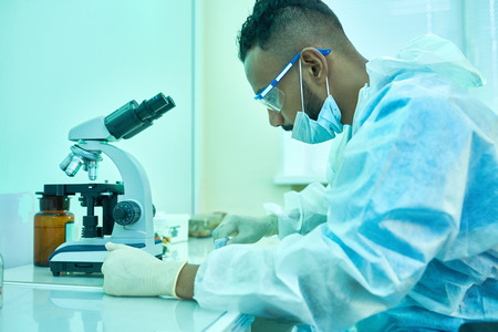 Puzzled research scientist working in laboratory