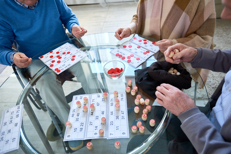 Unrecognizable Senior People Playing Lotto