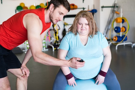 Obese Woman Doing Fitness Exercise Stock Photo