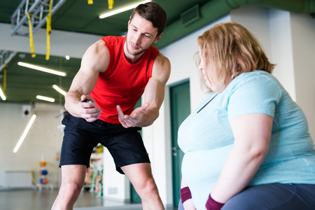 Fitness Coach Working with Client Stock Photo