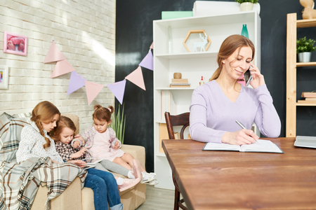 Young Mother Wrapped up in Work