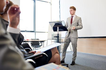 Confident Businessman at Podium