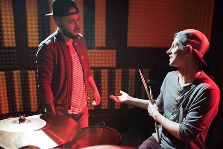 Music Band Members in Recording Studio