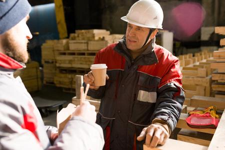 Workers Drinking Coffee in Workshop