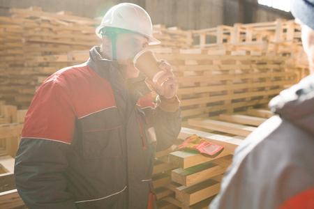 Mature Factory Worker at Coffee Break Imagens
