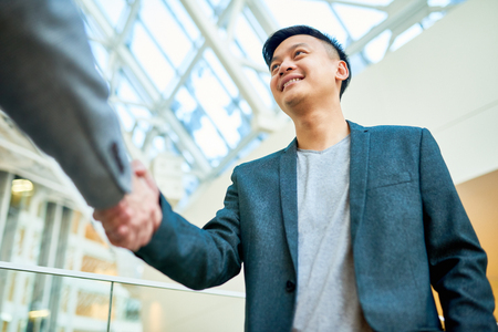 Greeting Colleague with Handshake
