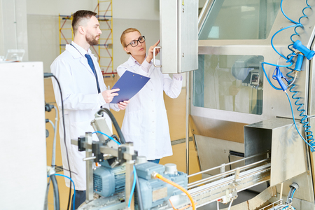 Adjusting Equipment at Milk Plant