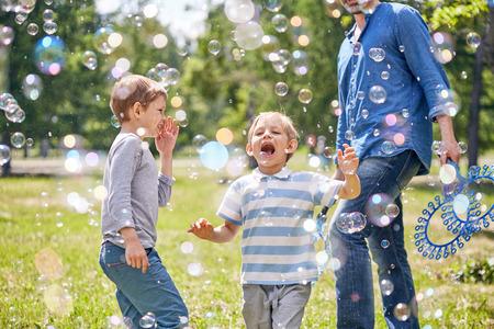 Funny Little Boy with Soap Bubbles Banque d'images - 100780764