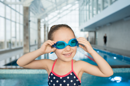 Happy little swimmer in modern pool Stockfoto