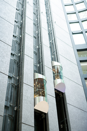 Modern elevators in office lobby