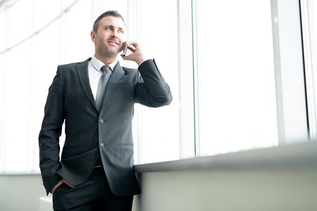 Successful male entrepreneur talking on phone