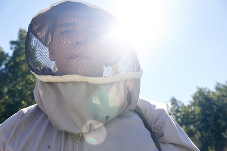 Young Apiarist in Sunlight