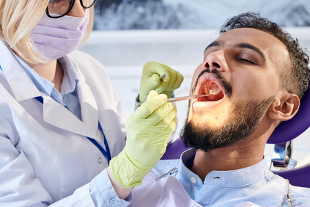 Professional Stomatologist Wrapped up in Work Stock Photo