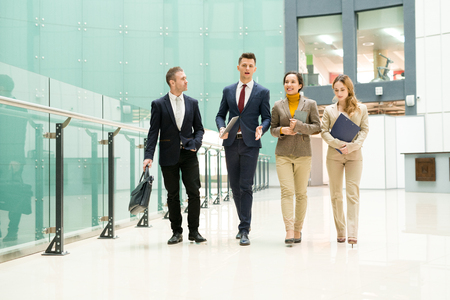 Handsome agent presenting company to business people