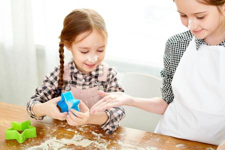 Preparing Delicious Cookies with Elder Sister Stock Photo