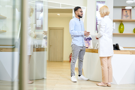 Giving Explanations to Bearded Patient Stock Photo