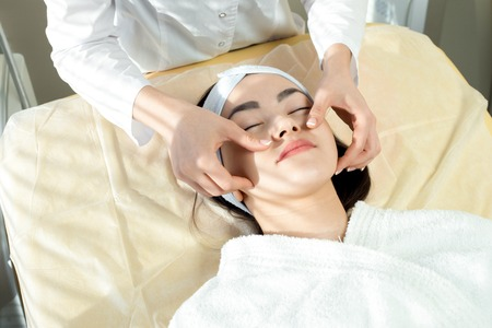 Asian Woman Enjoying Face Massage