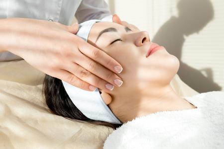 Woman Enjoying Face Massage Stock Photo - 100439552