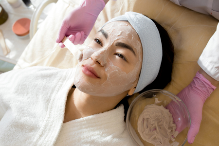 Asian Woman Enjoying Beauty Treatment in SPA