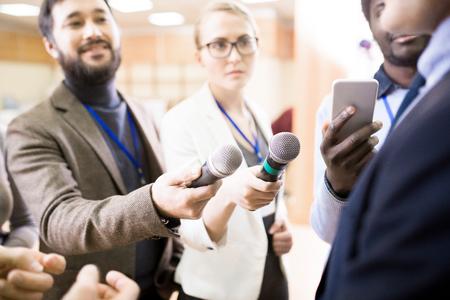 Reporters Holding Microphones