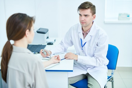 Doctor Working with Patient 스톡 콘텐츠