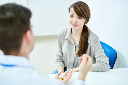 Female Patient Visiting Doctor Stock Photo
