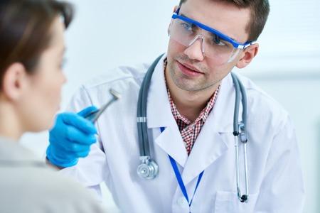 Otolaryngologist Examining Patient
