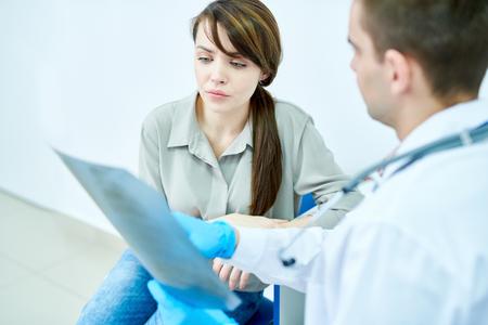 Doctor Explaining X-Ray Image Stock Photo