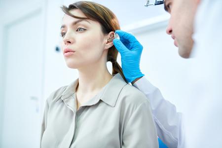 Audiologist Examining Woman