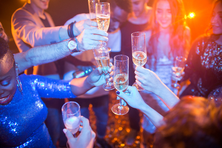 People Raising Glasses at Club Party