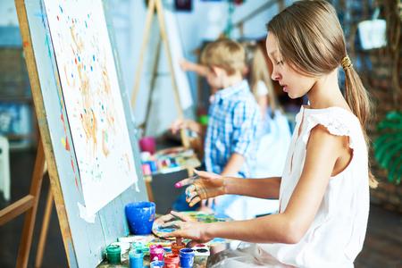 Talented Little Girl in Art Studio Foto de archivo