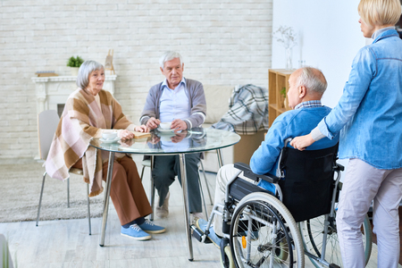 Group of senior people in assisted living home Stock Photo