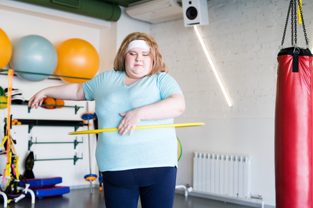 Obese Woman Working Out with Hula Hoop