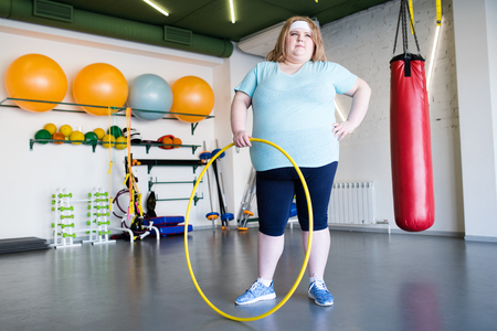 Obese Woman Posing with Hula Hoop