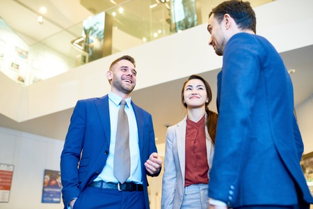 Young Business People Chatting at Work Stock Photo