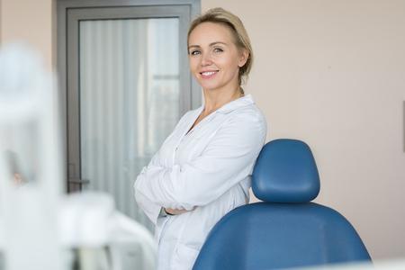 Pretty Female Dentist Posing in Clinic Standard-Bild - 102080177