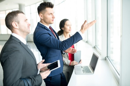 Ambitious Businessman Pointing to Window Stock Photo