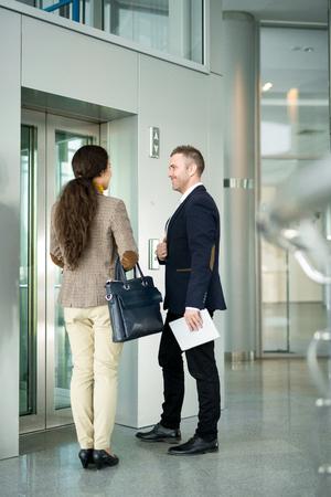 Business People Waiting by Elevator Foto de archivo