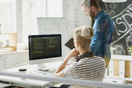 Two Modern Web Developers at Work Фото со стока