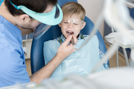 Little Boy Suffering from Toothache Stock Photo