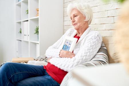 Sad Senior Woman Remembering Husband