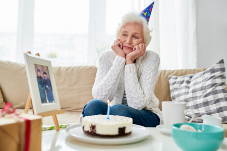 Lonely Senior Woman Celebrating Birthday Stock Photo