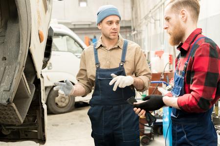 Mechanics Discussing Truck Breakdown
